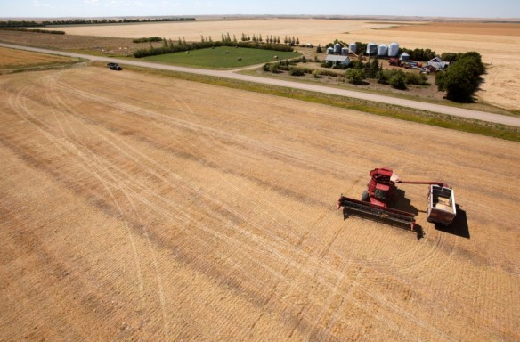 A harvester filling a grain truck by St Louis Aerial Photography and Video