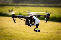 DRONE SUNSET UAV UNMANNED AIRCRAFT IN FLIGHT
